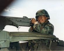 Jimmie Dalton Handling Machine Gun.jpg