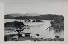 Barge with Truck Offloading Debris