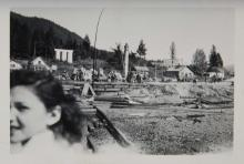 Woman with Post Fire Relief in the Background