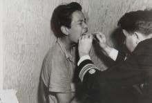 A Young Man Receives Medical Attention Post Fire