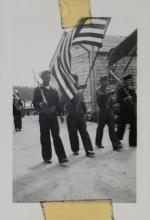 Hoonah Military Marching with Flags and Rifles