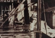 David Williams Standing in the ANB Hall Under Construction