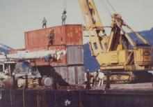 Connex Stack on Barge with Clevenger Logging Equipment