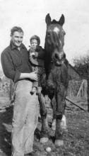 Clarence Peterson and Kermit Brandt with a Horse