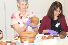 Marjorie Peterson and Daphne Wright Looking at Baskets